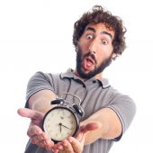 Young crazy man surprised with a clock — Foto Stock
