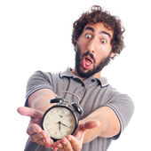 Young crazy man surprised with a clock — Stockfoto