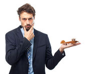 Young crazy businessman with a wooden plane — Stock Photo
