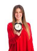Young cool girl with an alarm clock — Stock Photo