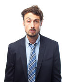Young crazy businessman confused face — Stock Photo