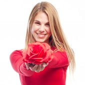 Young cool woman with a rose — Stock Photo