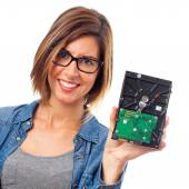 Young cool woman with broken hard disk — Stock Photo