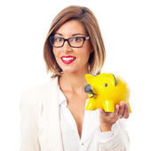 Young cool woman with a piggy bank — Stockfoto