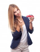 Young cool woman with car toy — Stock Photo