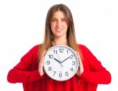 Young cool girl with a clock — Stock Photo