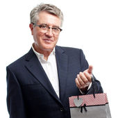 Senior cool man with shopping bag — Stock Photo