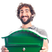 Young crazy man with a mail box — Stock Photo