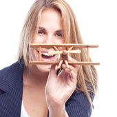 Young cool woman with a wooden plane — Stock Photo