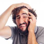 Young crazy man with head pain — Stockfoto