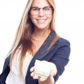 Young cool woman with a gift box — Stock Photo