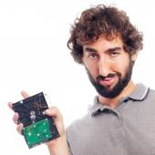 Young crazy man with a hard disk — Stock Photo
