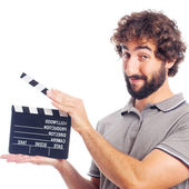 Young crazy man with a clapperboard — Foto de Stock