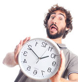 Young crazy man worried with a clock — Foto Stock