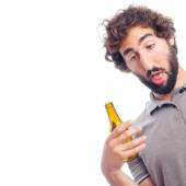 Young crazy man with a beer — Stock Photo