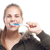 Young cool woman brushing her teeth — Stock Photo