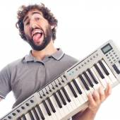 Young crazy man with a piano — Stock Photo