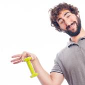 Young crazy man with a small dumbbell — Stock Photo
