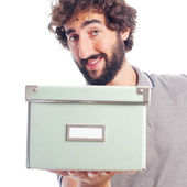Young crazy man with a box — Stock Photo