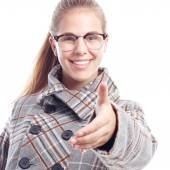 Young cool woman shaking hand — Stock Photo