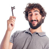 Young crazy man with an old key — Stock Photo