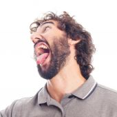 Young crazy man shouting with a megaphone — Stock Photo