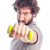 Young crazy man with a dumbell — Stock Photo