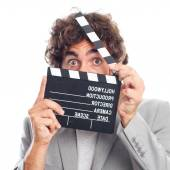 Young crazy man as a movies director — Stock Photo