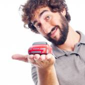 Young crazy man with a car toy — Stock Photo