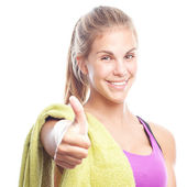 Young cool woman with a dumbbell and a towel all right gesture — Foto de Stock
