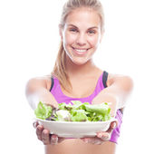 Young cool woman with a salad — Stock Photo