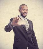 Young cool black man with name card — Stock Photo
