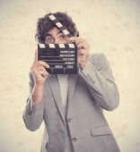 Young crazy man as a movies director — Stockfoto