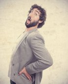 Young crazy man with back pain — Stock Photo