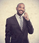 Young cool black man speaking on phone — Stock Photo