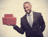 Young cool black man with boxes — Stock Photo