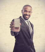 Young cool black man with giftbox — Stock Photo