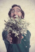 Young cool man with a plant — Stock Photo