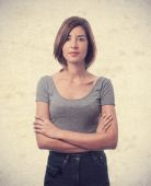 Young cool woman crossed arms and confidence — Stock Photo