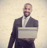 Young cool black man offering a box — Stock Photo