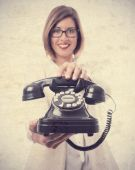 Young cool woman with a telephone — Stockfoto