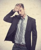 Young crazy businessman boring gesture — Stock Photo