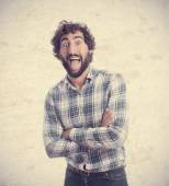 Young man sticking out tongue — Stock Photo