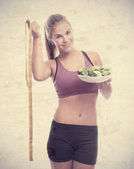 Young cool woman with a salad and a meter — Stock Photo