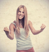 Young cool woman celebrating sign — Stockfoto