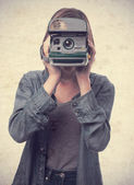 Young cool woman with a camera — Stockfoto