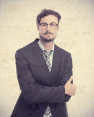 Young crazy businessman arms crossed — Stock Photo