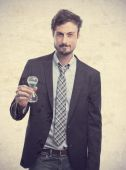 Young crazy businessman with a timer — Stock Photo