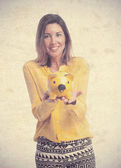 Young cool woman with piggy bank — Stockfoto