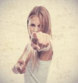 Young cool woman pointing you — Stockfoto